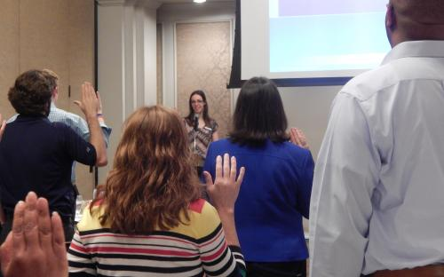 Kristen leads group in the CPCU pledge